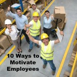 Happy group of workers at a warehouse with thumbs up and looking at the camera