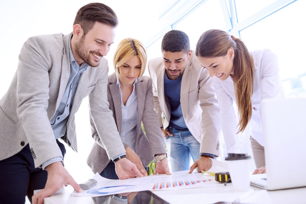 Image of four successful business partners working at meeting in office.Group of business people discussing.They are working on a new project.
