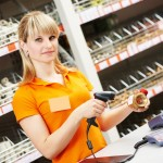 seller cashier with bar code scanner scanning plumber valve at store