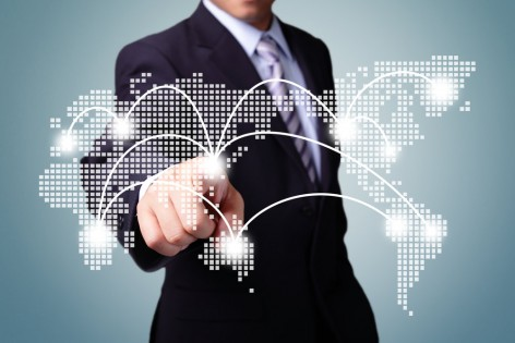 Global Business, technology, internet and networking concept - business man pressing world map ( pointing asia )