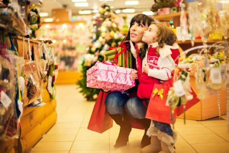 Mother and daughter buying Christmas decoration and gifts in a shop